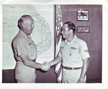 Col Victor Lisec awarding Bronze Star to Sgt Jim Wade, March, 1970